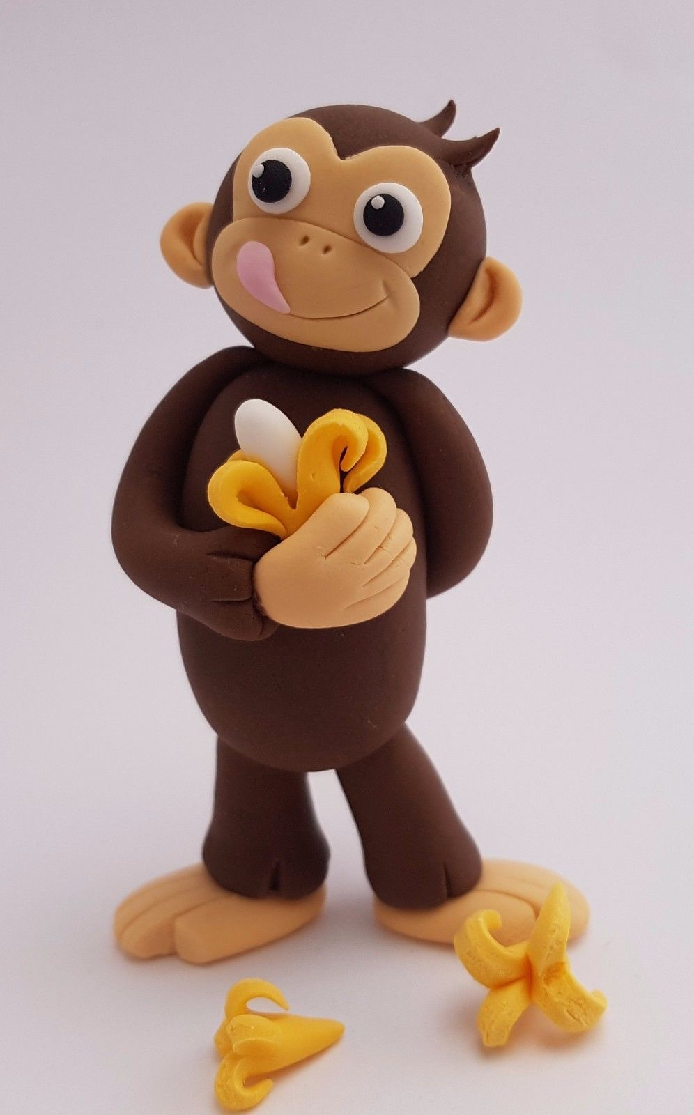 Curious George Edible Cake Decoration  from caketoppers-online.com